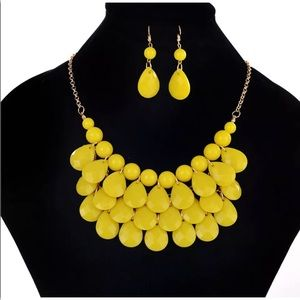 Statement necklace and earrings set.